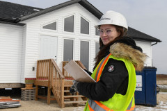 Kayla Heppner gets ready to do quality control inspections in our RTM homes.