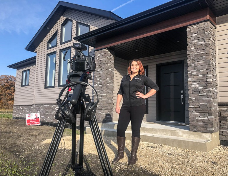 Chelsea McDermid working on another walkthrough video, this time at our Oakville Show Home.