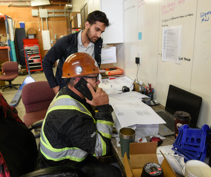 Ajay and Shane go over plans for our next Oakville show home,