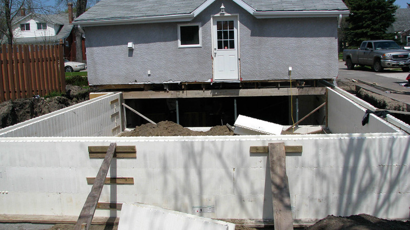 Portage la Prairie shored up house and put a new foundation under it.
