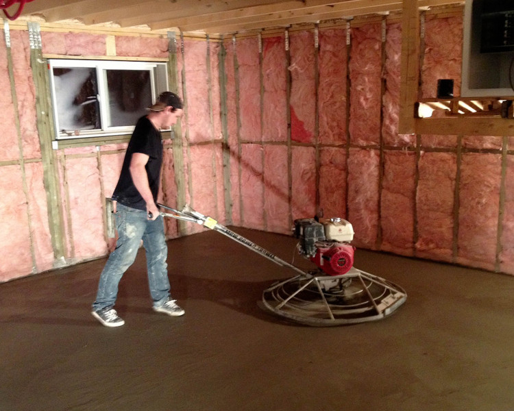 Nick finishing a basement floor.