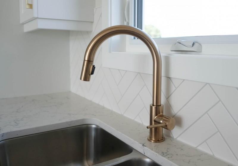 Gold kitchen tap.