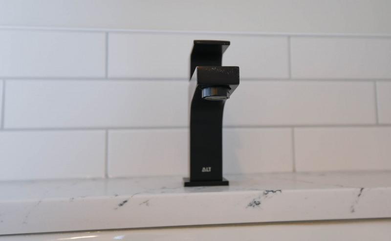 Black vanity taps.