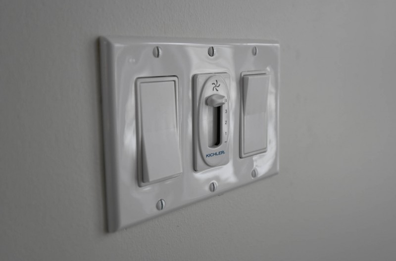 Bank of switches with ceiling fan controls.