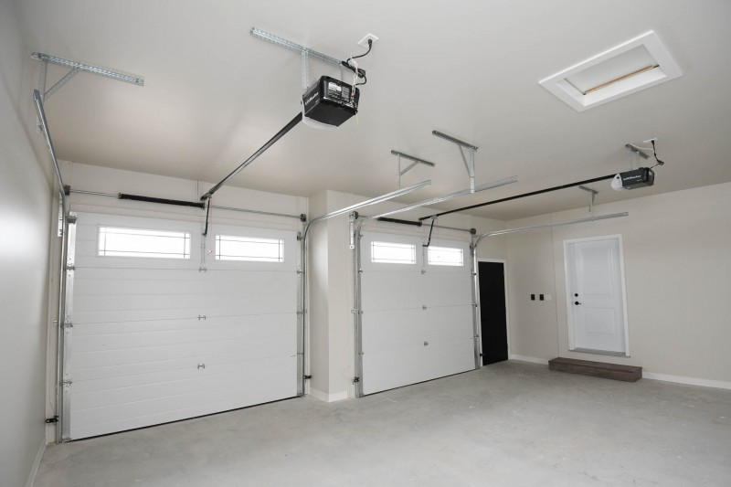 Two car garage 10x8 overheads with openers and windows